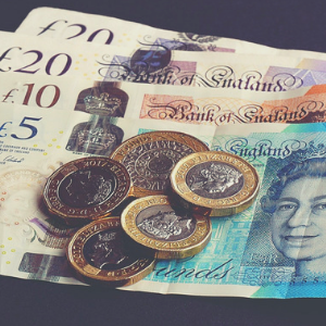 a close up of a english money notes and coins