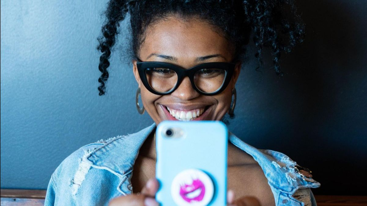 a person wearing glasses taking a selfie