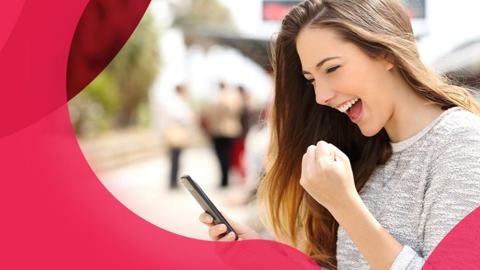 a woman looking at a phone and smiling