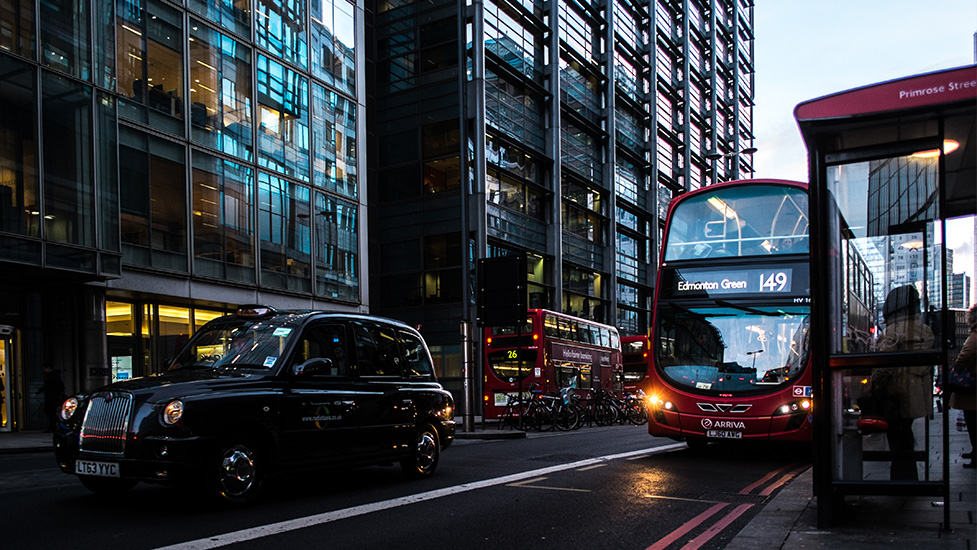 a bus driving down a busy city street