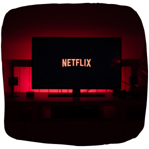 a tv with Netflix on in a dark room