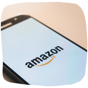 a close up of a device with amazon logo on the front screen