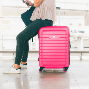 a person sitting on a suitcase