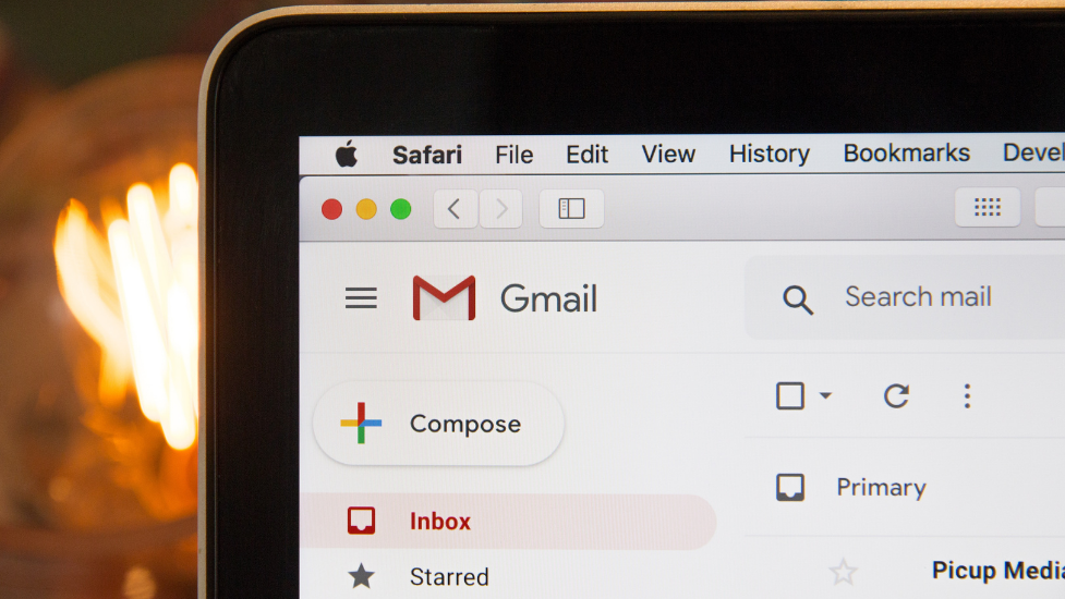 the corner of a computer screen with gmail showing