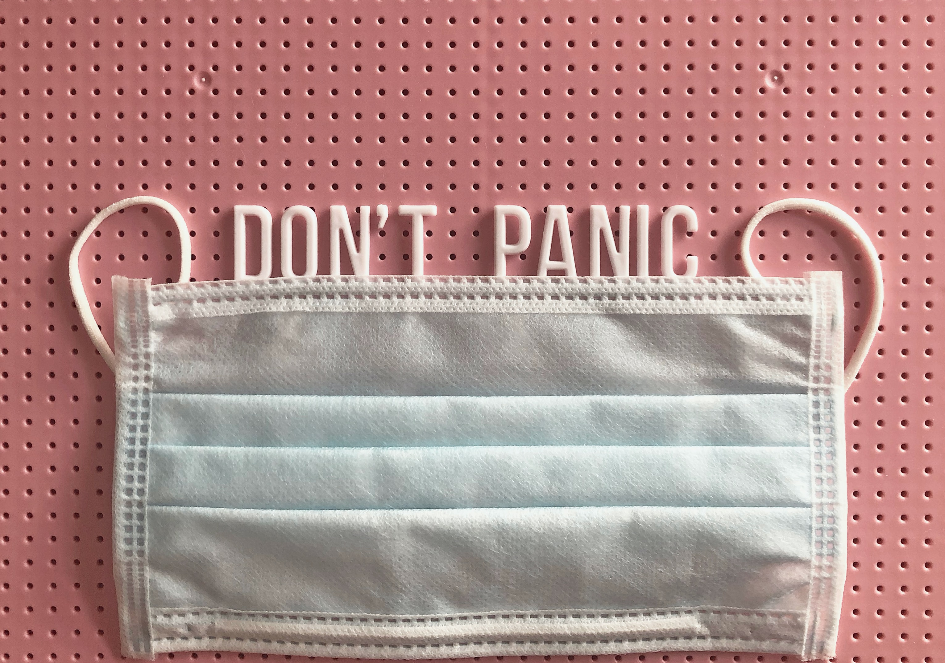 Face mask with the word 'Don't panic' above