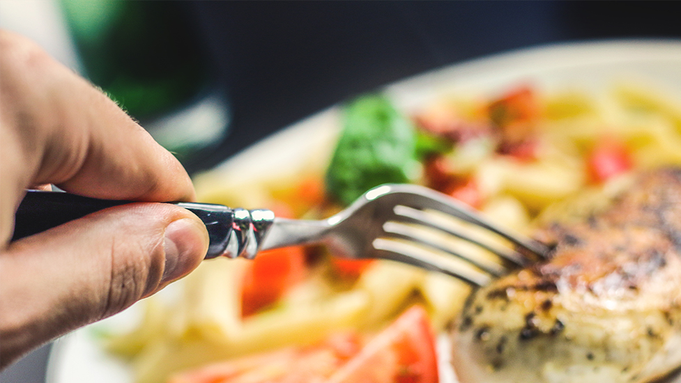 a close up of a plate of food with a fork