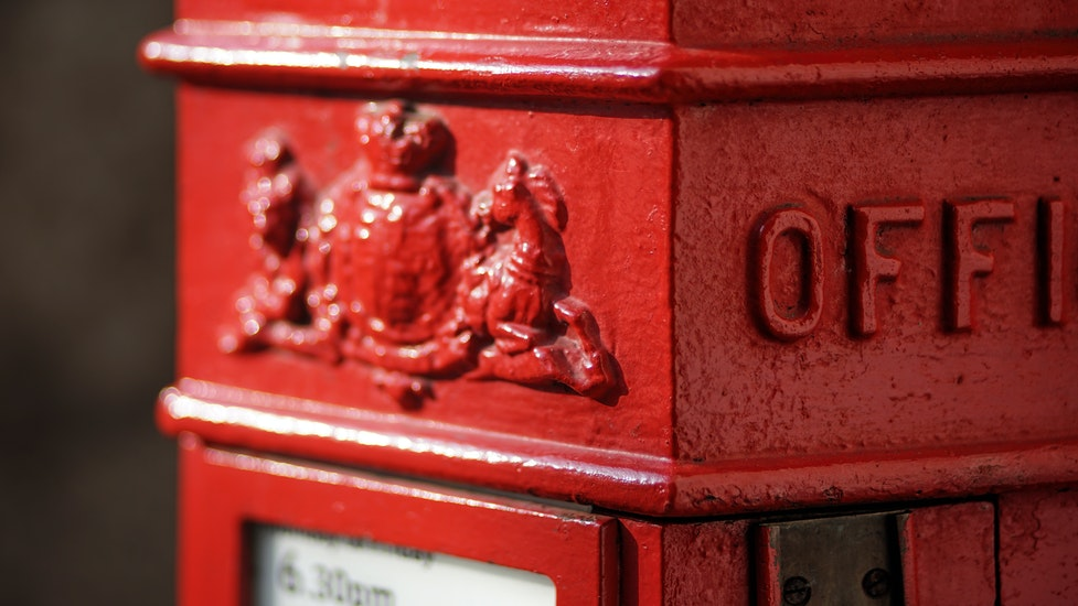 a close up of a post box