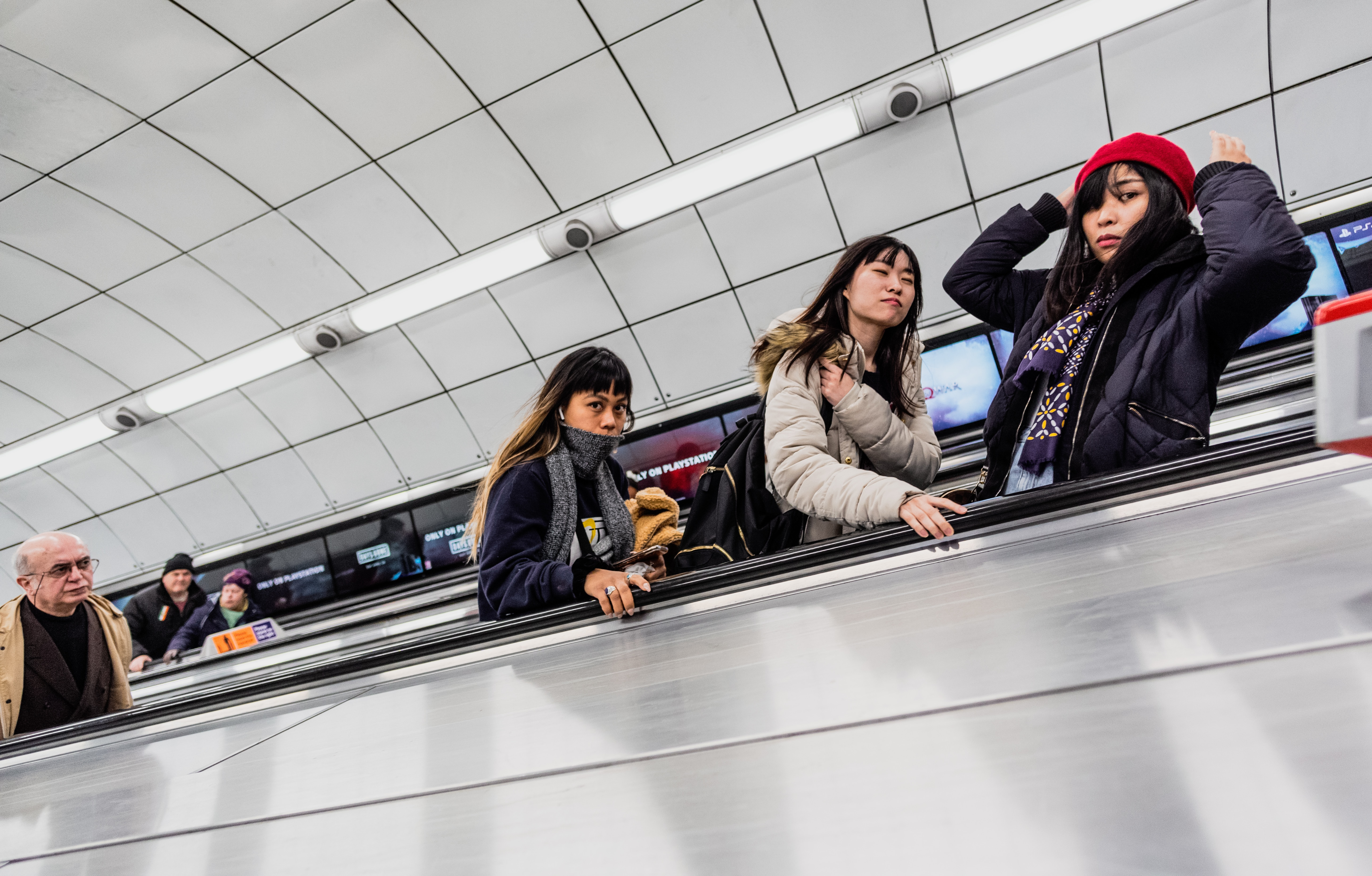 a group of people sitting at a train station