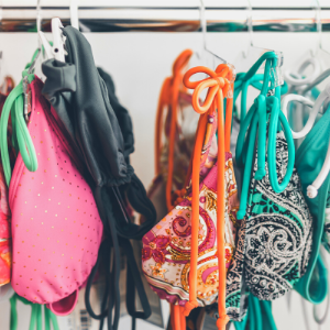 different coloured bikinis hanging up