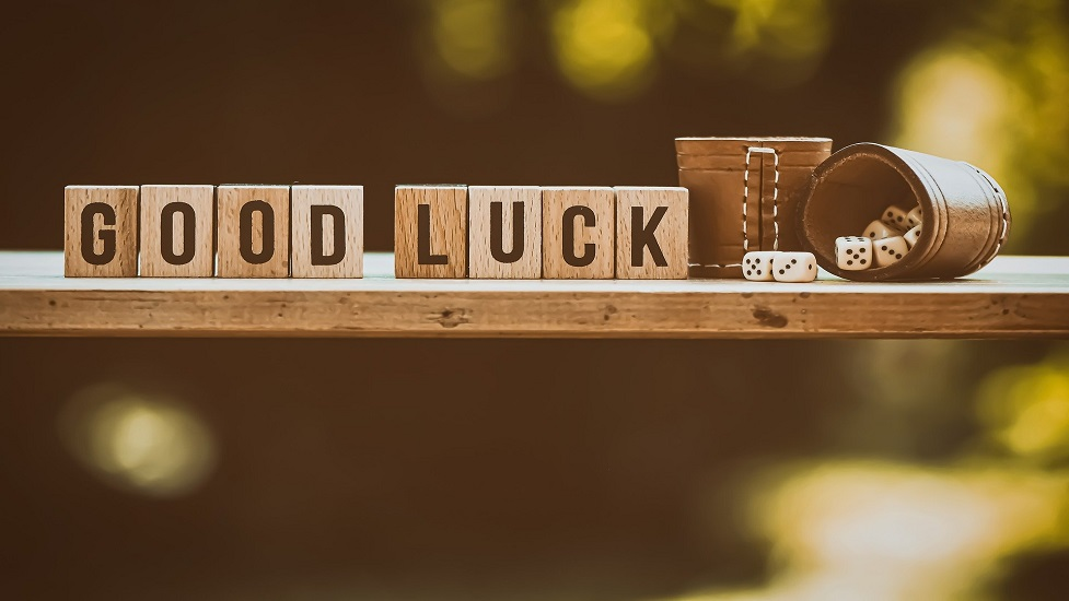a close up of a sign saying good luck