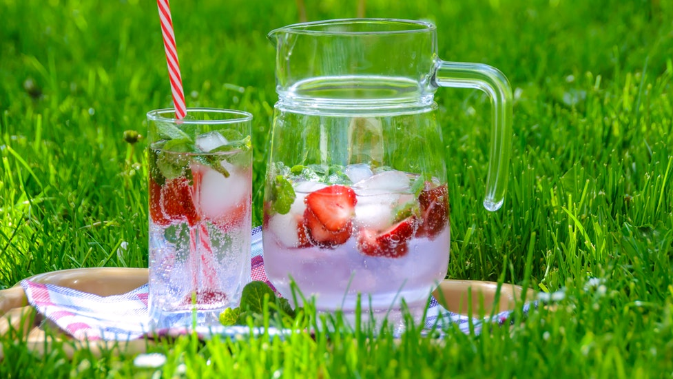 a close up of some grass with a summer drink