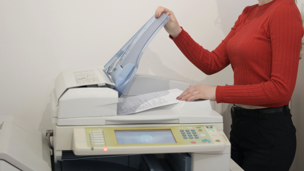 a person using a printer