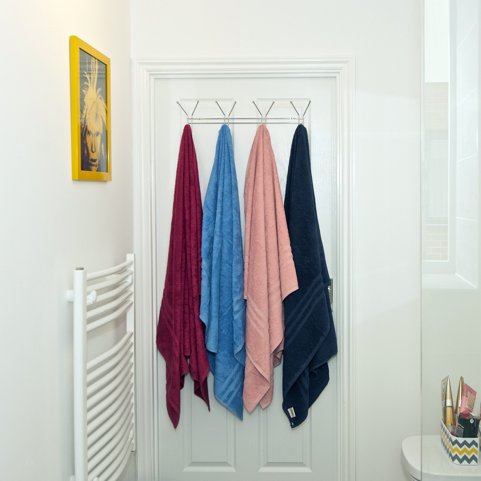 a close up of towels hanging on a wall