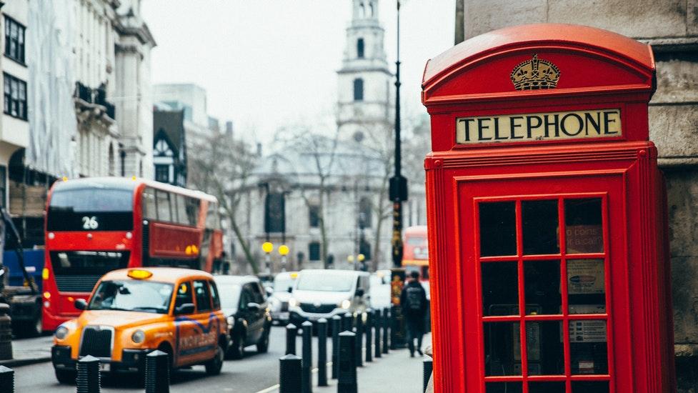 a telephone box on a city street